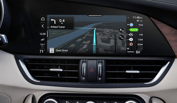 A close-up of the touchscreen in the 2020 Alfa Romeo Giulia with the Media icon selected.