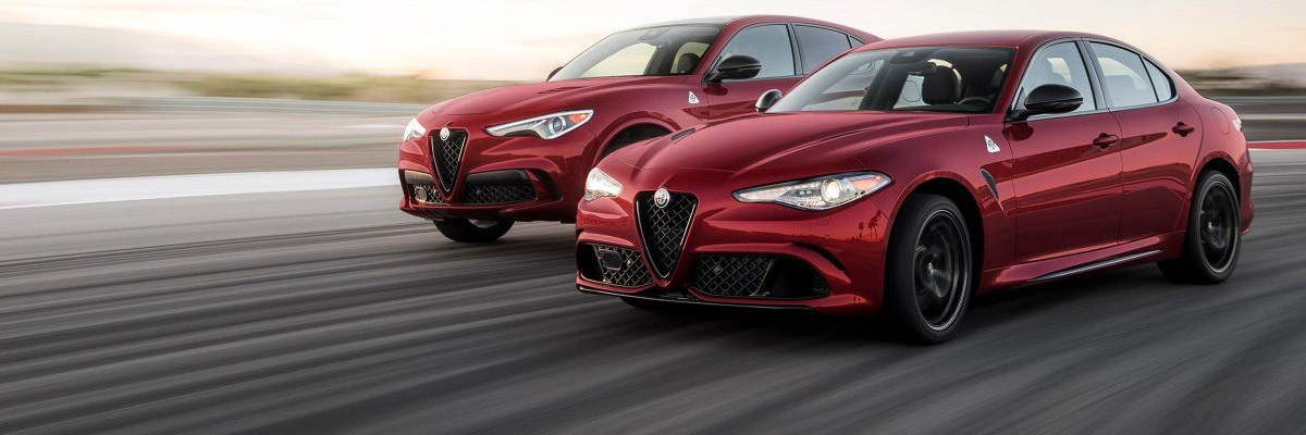 A 2020 Alfa Romeo Gulia and a 2020 Alfa Romeo Stelvio driving down a road