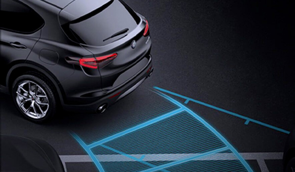 The sensors in the 2020 Alfa Romeo Stelvio tracking the path the vehicle is following as it reverses into a parking space.
