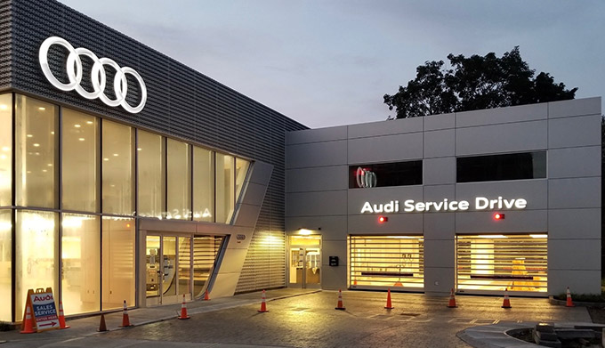 exterior view of Audi Brookline dealership showcasing service center