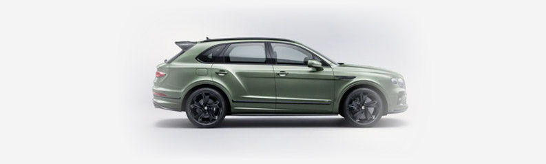 side profile of green 2021 bentley bentayga on a white studio background
