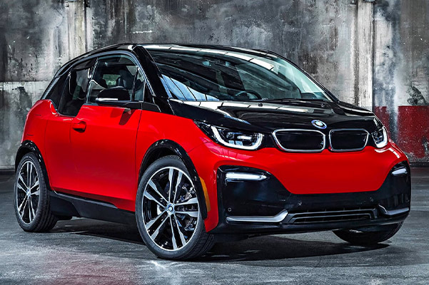 frontal profile view of 2020 BMW i3 parked on top of concrete and grunge painted walls