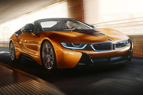 frontal profile view of 2020 BMW i8 accelerating through a bridge
