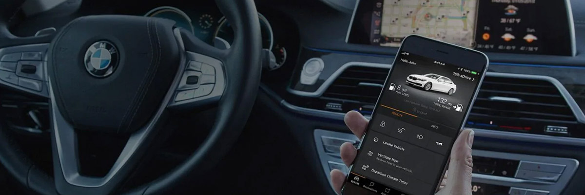 close up of hand holding phone on hand inside a bmw vehicle