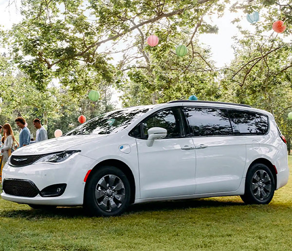 chrysler pacifica hybrid parked in the grass