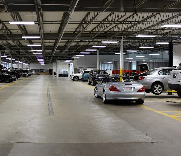 interior view of herb chambers collision center featuring vehicle vehicles getting repaired