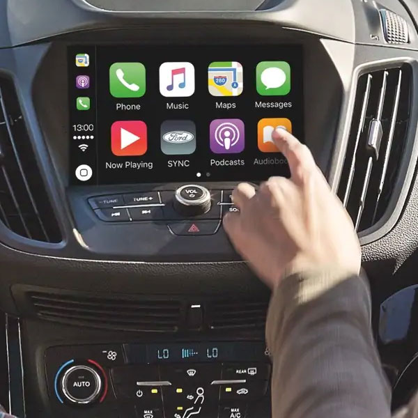 close up of hand touching for digital screen feauting apple car play