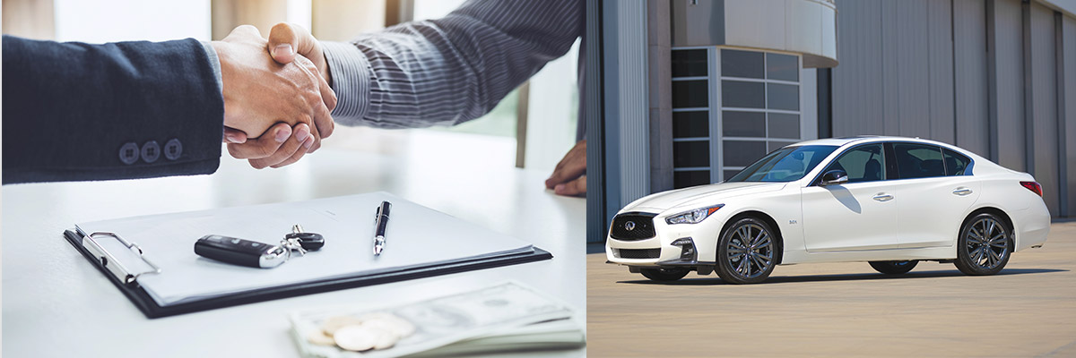 side profile of INFINTI Q50 sedan in white color parked outside a gray building