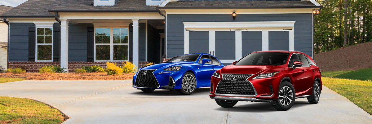 a blue lexus IS sedan next to a red lexus RX suv parked outside of a house on the driveway