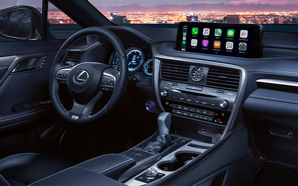 interior shot of Lexus RX suv featuring dashboard and digital screen