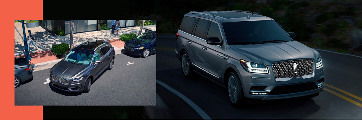 a silver lincoln navigator showcasing parking assist capabilities between two cars