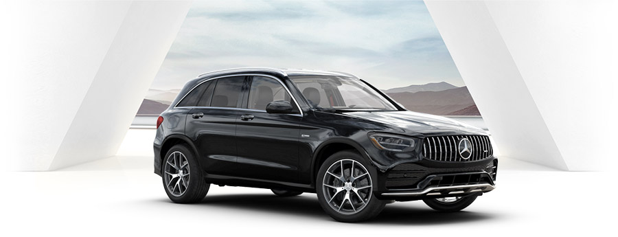 black Mercedes-AMG® GLC 43 suv on a white studio background