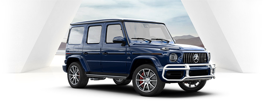 blue Mercedes-AMG® G 63 suv on a white studio background