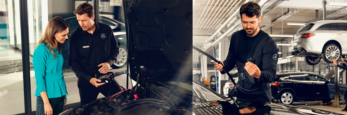 Mercedes Benz auto Technician performing service with a scanner in his hand