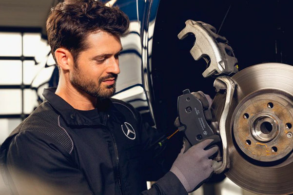 Mercedes benz technician installing new brakes on a mercedes benz vehicle