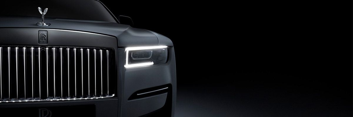 close up shot of Rolls Royce Ghost headlight on