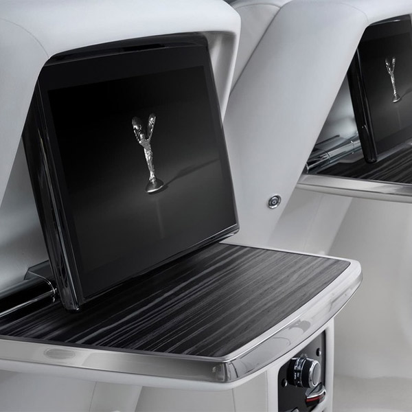 close up shot of digital screens in the back of Rolls Royce Ghost seats