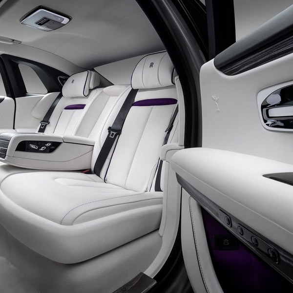interior view of Rolls Royce Ghost featuring back leather seats in white color