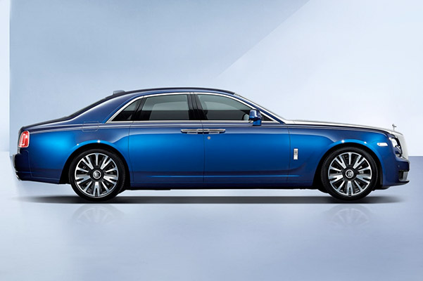 a blue Rolls-Royce Ghost vehicle on a blue studio artistic background