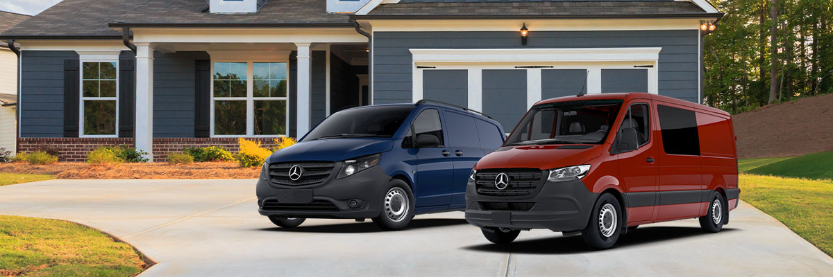 blue Mercedes-Benz metris cargo van next to a red Mercedes-Benz sprinter van parked outside of a house on the driveway