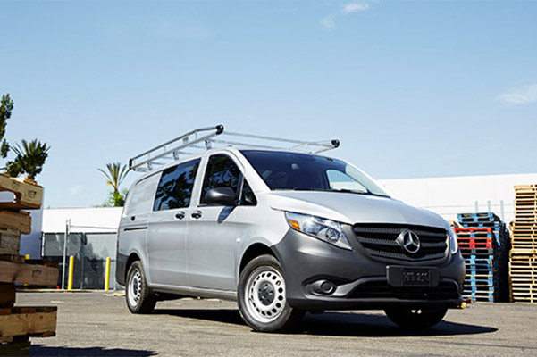 a silver Mercedes-Benz metris van on a loading dock background